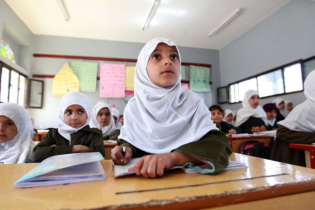 Yemeni schoolgirls attend a class on February 26, 2015 in the capital Sanaa. Yemen, long on the front line in the fight against Al-Qaeda, has been wracked by violence since the ouster of longtime autocrat Ali Abdullah Saleh in February 2012 following a year-long popular uprising.   AFP PHOTO / MOHAMMED HUWAIS        (Photo credit should read MOHAMMED HUWAIS/AFP/Getty Images)